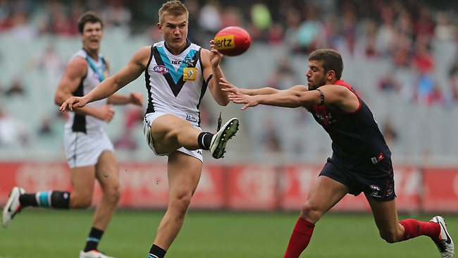 Oliver Wines of the Power kicks the ball during Power's win over Melbourne (Photo by Scott Barbour/Getty Images)