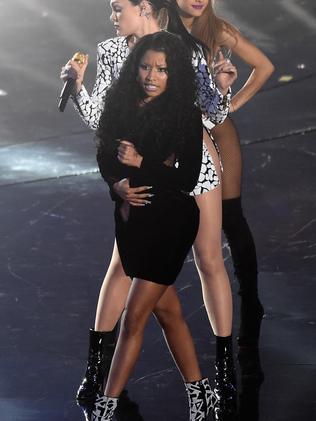 Nicki Minaj holds her dress closed while performing. Picture: Michael Buckner