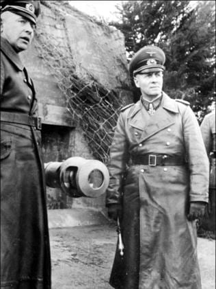 "General chaos ... Adolf Hitler's insistence at personally instructing the defence of Europe saw German Marshal Erwin Rommel, right, seen inspecting the ""Atlantic wall"" defences in France, sidelined."