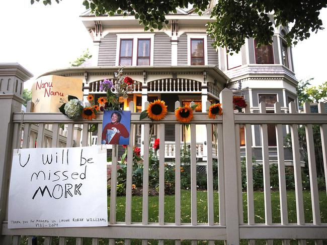 A makeshift memorial for Robin Williams is set up in front of the Mork & Mindy home in Boulder, Colorado.