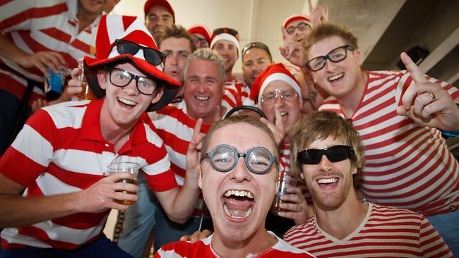 Aussie fans dressed as Where's Wally from the children's classic book celebrate a wicket on the Boxing Day test. Picture: Jake Nowakowski