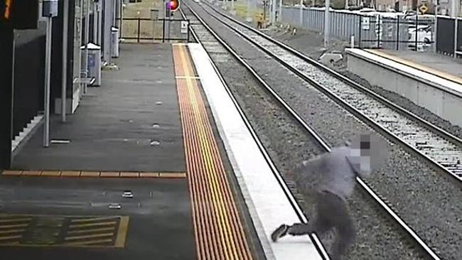 CCTV footage of a man falling onto the rail lines while using his phone.
