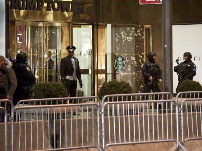 New York Police Department anti-terror police secure the area around Trump Tower in New York. Picture: AP Photo/Bebeto Matthews