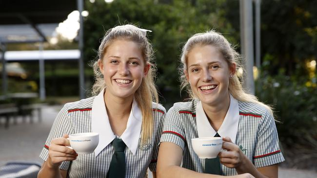 St Pauls year 12s Emma and Rachel Slade with coffees from their on-campus coffee shop. Picture: Josh Woning