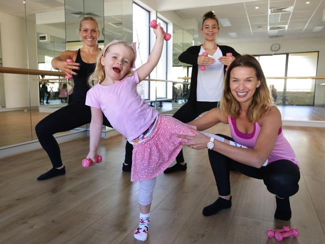 Aussie model Tahyna Tozzi, right, is a devotee and instructor of extend barre, with Liz Nable, Ruby Nable (4) and Ruby Tozzi.