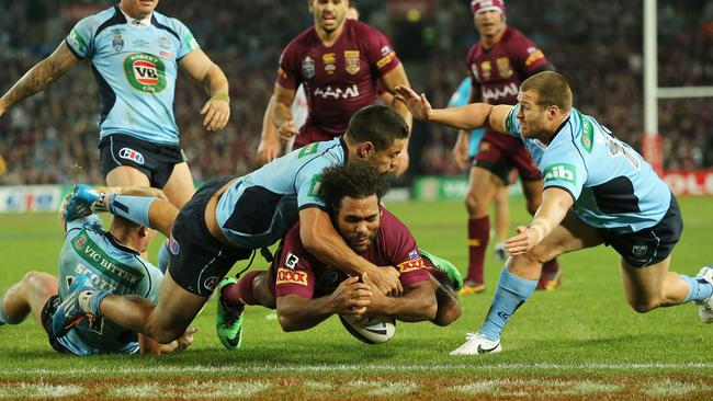 Sam Thaiday drops the ball as he goes over the try line.