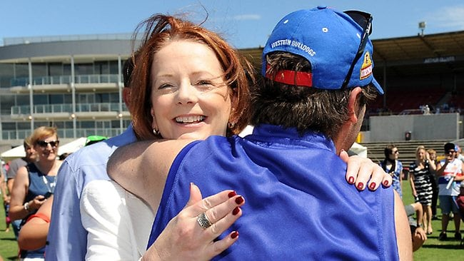 Prime Minister Julia Gillard in Melbourne the day before the leadership ballot. She went to the Western Bulldogs family day at Whitten Oval. She was hugged by a supporter as she arrived Picture: Ellen Smith