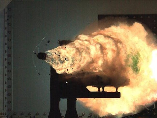A photo of the moment a shell leaves the barrel of a US navy electromagnetic rail gun that can fire projectiles at 8700km/h — without the aid of gunpowder.