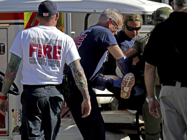 Medical personnel tend to a victim following the horrific shooting in Parkland. Picture: John McCall/South Florida Sun-Sentinel/AP