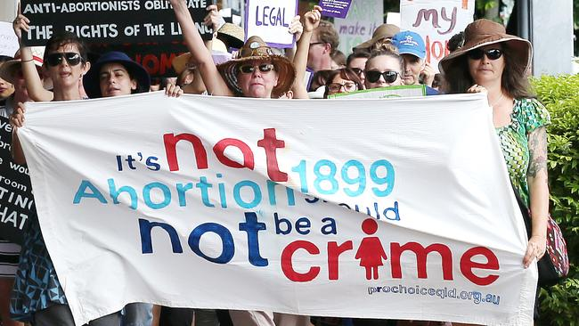 """Pro-choice supporters held a rally and marched under the banner of """"Our Bodies, Our Lives, Our Choice"""" in support of the two bills before state parliament to decriminalise abortion in Queensland. Picture: Justin Brierty"""