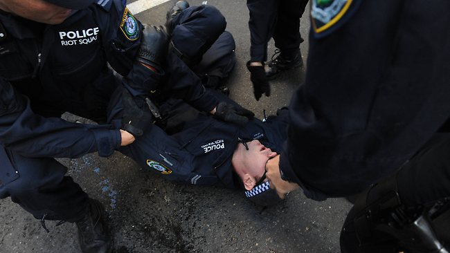 Police injured ... at an Islamic protest in the streets of Sydney from Hyde Park to George Street. Picture: Simon Bullard