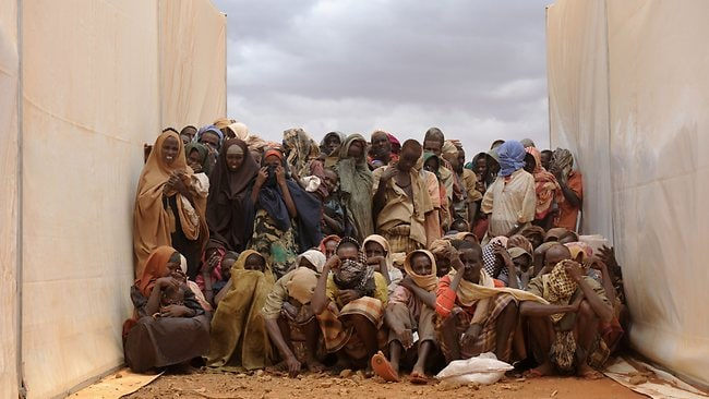 Somali refugees cluster between two food tents as they wait to be called to collect food aid at the Kobe refugee camp in Ethiopia.Thousands of Somalis have fled in recent months to neighbouring Ethiopia and Kenya in search of food and water, with many dying along the way. Picture: AFP