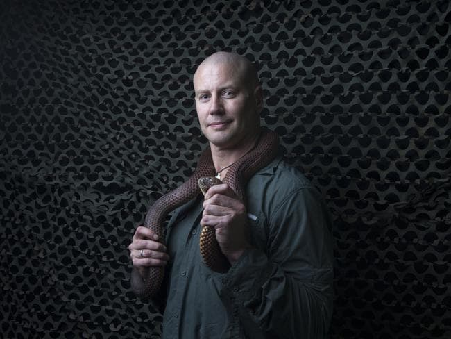 Dr Bryan Fry holding a 2m King Brown Snake. Picture: Russell Shakespeare
