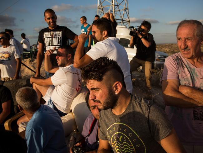 Civilians gather to watch Israeli attacks from the top of a hill at Sderot. Picture: Andrew Burton/Getty Images