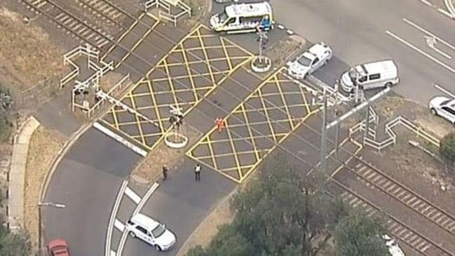 Emergency services on the scene after a woman was hit by a train. Picture: Channel 7