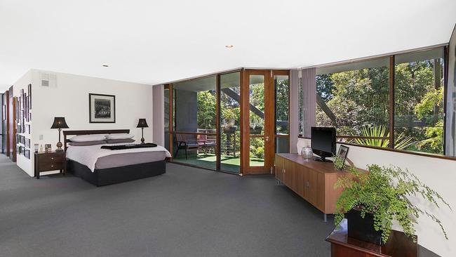 The main bedroom is a sprawling suite with private balconies.