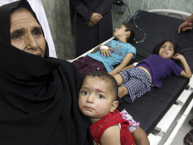 Innocent victims ... wounded Palestinians wait for treatment following an Israeli air strike on their family house at the treatment room of al Najar hospital in Rafah in the southern Gaza Strip.