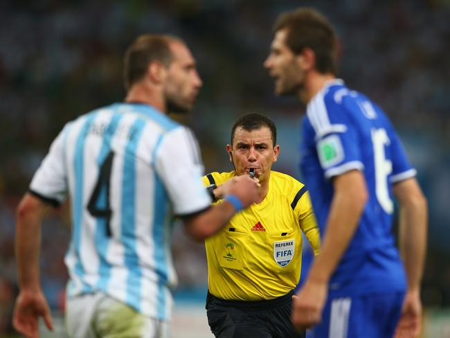 Referee Joel Aguilar breaks up an argument between Pablo Zabaleta and Senad Lulic.