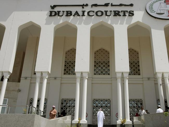 A closeup shot shows the facade of the Dubai Courts building during a hearing on April 04, 2010 in the case of a British couple sentenced to a month in jail after being convicted of kissing in public in a restaurant in the Muslim Gulf emirate. The couple's lawyer said the appeals court upheld the one-month prison sentence against the two, named by the British press as Ayman Najafi, 24, a British expat, and tourist Charlotte Lewis, 25. The couple were arrested in November 2009, after they were accused of consuming alcohol and kissing in a restaurant in the trendy Jumeirah Beach Residence neighbourhood.     AFP PHOTO/STR