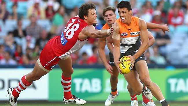 SYDNEY, AUSTRALIA - MARCH 30: Dylan Shiel of the Giants breaks the tackle of Mike Pyke of the Swans during the round one AFL match between the Greater Western Sydney Giants and the Sydney Swans at ANZ Stadium on March 30, 2013 in Sydney, Australia. (Photo by Ryan Pierse/Getty Images)
