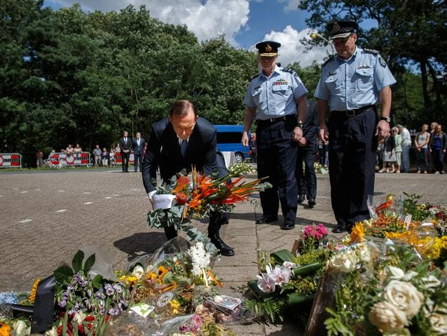 major boost in latest Newspoll ... Prime Minister Tony Abbott lays a wreath in remembrance of the victims of Malaysia Airlines flight MH17 in Hilversum, Netherlands. Picture: Getty Images