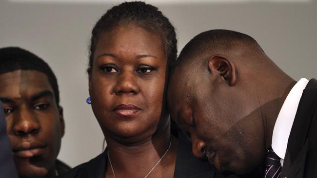 Lost son ... Sybrina Fulton with Trayvon Martin's brother Jahvaris Fulton and family lawyer Benjamin Crump. Picture: AP Photo/Jacquelyn Martin