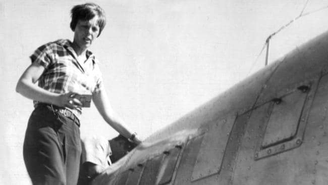 Amelia Earhart stands on the wing of her Lockheed Electra aeroplane in Darwin.