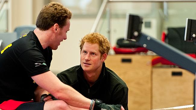 Military man ... Prince Harry chats with a veteran at the launch of the Invictus Games in Tidworth, as reports say he has split with Cressida Bonas. Picture: Getty