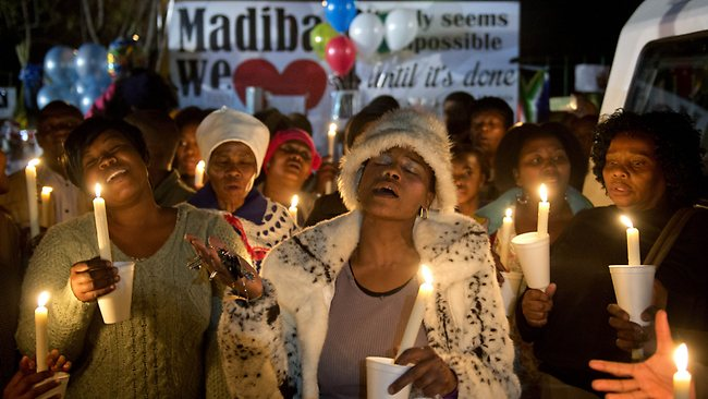 A group of well wishers hold candles as they pray for the recovery of Nelson Mandela outside the Mediclinic heart hospital in Pretoria.