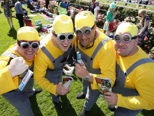 Punters dressed as Minions. 2015 Melbourne Cup Day at Flemington Racecourse. Picture: Andrew Taubman