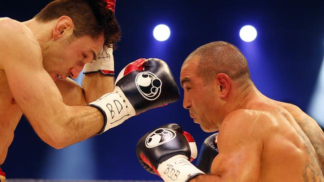 Former IBF Middleweight Champion Felix Sturm, left, punches Sam Soliman during their IBF Middleweight title bout.