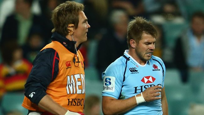 Drew Mitchell of the Waratahs leaves the field injured.