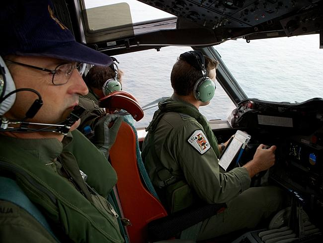In flight ... the crew of an RAAF AP-3C Orion aircraft. Pic: Richard Wainwright.