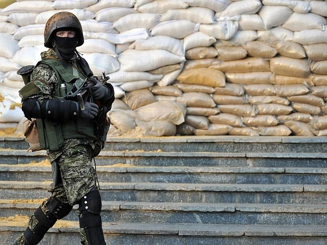 Defiant ... pro-Russian rebels kept their grip on seized government buildings in Ukraine, a day after Kiev struck a deal with Russia and the West aimed at easing the crisis in the ex-Soviet republic. Picture: Genya Savilov