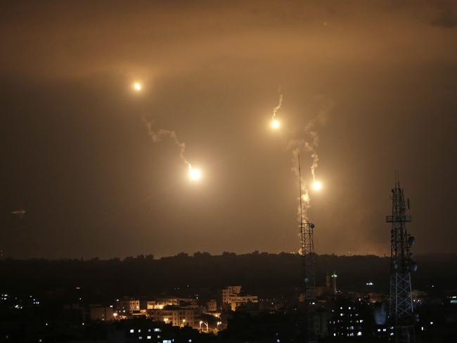 Israeli forces flares light up the night sky in the east of Gaza City yesterday.. Picture: Khalil Hamra