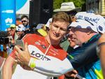 Andre Greipel from Lotto Soudal looks at a photo by a spectator Picture: Brenton Edwards/AFP Photo