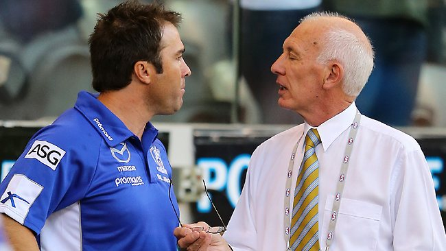 Geelong v North Melbourne at Etihad Stadium, Docklands. Brad Scott talking with the AFL's ( Graham Finn ? ) ground manger after the loss about the roof policy after the loss. Picture: Salpigtidis George