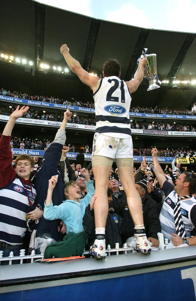 The iconic image of Mooney post the 2009 Grand Final.