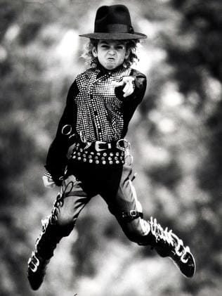 Australian dancer Wade Robson (pictured as a child in 1990) wears the shirt Michael Jackson wore in TV special Motown 25 and the hat Jackson gave him.