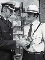 <p>The pith helmet with puggaree hat band and hand-held radio were part of the Victoria Police uniform in 1963. Picture: Victoria Police Museum Collection</p>
