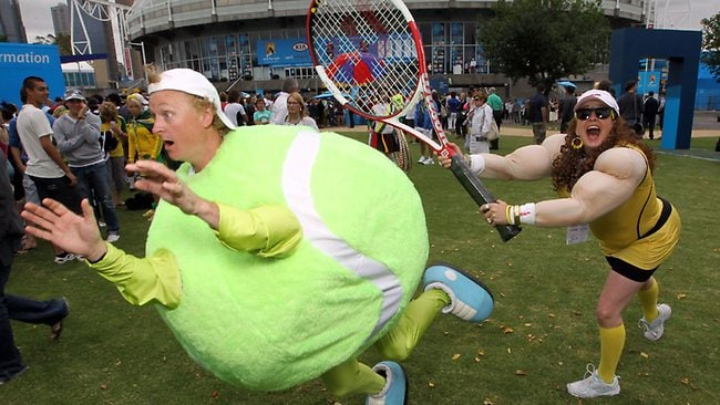 2011 Australian Open. Tennis. Day 1. Crowds and Faces. 'Samantha Molik' smashes 'The Whacky Tennis Ball'
