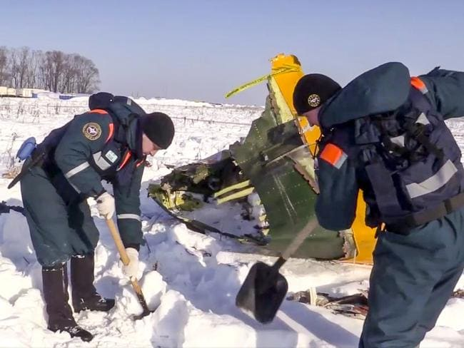 Emergency team workers at the scene of a AN-148 plane crash in Russia. Picture: Russian Ministry for Emergency Situations photo via AP