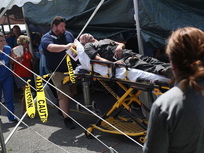 A patient is wheeled to an ambulance after passing out at the Remote Area Medical (RAM), mobile clinic on July 21, 2017 in Wise, Virginia. Picture: Getty.