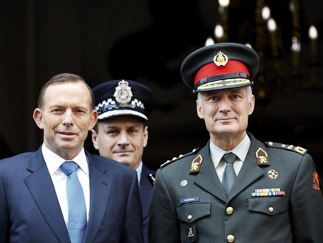 Task not yet complete ... Prime Minister Tony Abbott with Dutch Chief of Defence, Tom Middendorp (right) aon the search for remains and debris from Malaysia Airlines flight MH17. Picture: AFP