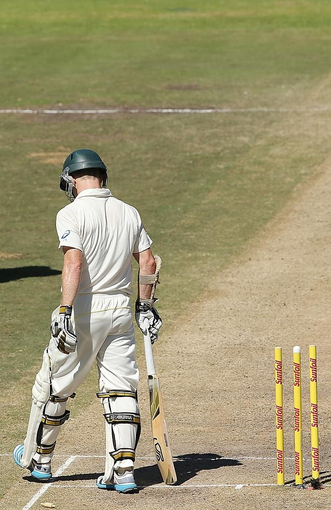 Rogers walks off after being run out by Dale Steyn.