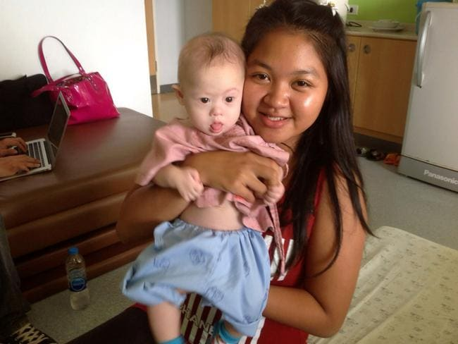 Thai surrogate mother Pattaramon Chanbua poses with baby Gammy at the Samitivej Hospital on August 6, 2014 in Chonburi province in Bangkok, Thailand. Picture: Getty Images
