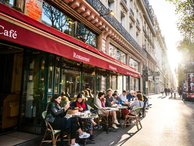 Our penchant for dining out at tourist hot spots has cost us close to a billion dollars in the last year.