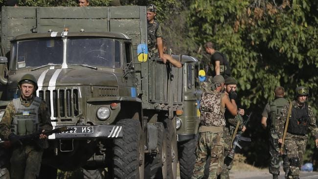 Show of force ... Ukrainian soldiers arrive to reinforce their positions in the village of Bezimenne, eastern Ukraine. Picture: AP