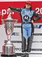 QUEEN of the track, NASCAR driver Danica Patrick poses with trophy on the podium after winning Bridgestone Indy Japan 300 in 2008. Picture: Shuji Kajiyama