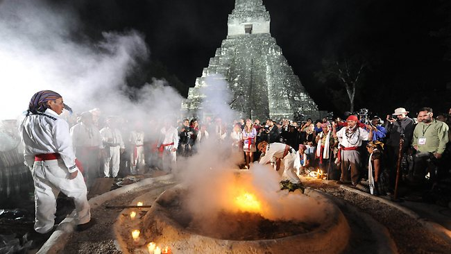 Mayan shamans take part in a ceremony on December 21, 2012, celebrating the end of the Mayan cycle known as Bak'tun 13 and the start of the Maya new age, at the Tikal archaeological site, Peten departament, 560 kms north of Guatemala City. AFP PHOTO/Johan ORDONEZ